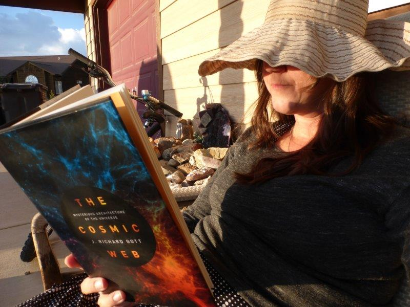 Natalie reads the Cosmic Web book at sunset