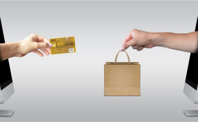 hands coming out of computer with credit card and shopping bag